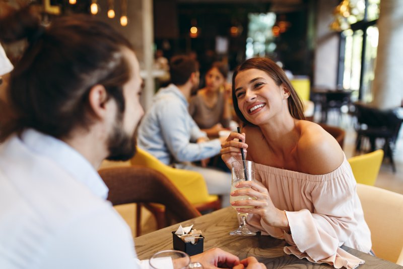 Couple smiling at each other on dinner date